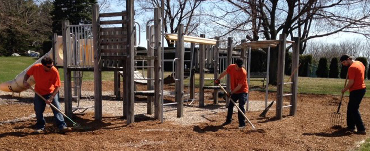 UMT Public Works Crew spreading fresh mulch at Township playground